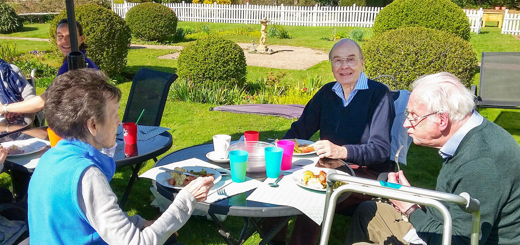 Evendine House Care Home residents enjoying sunshine fullwidth image